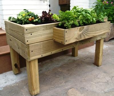 Fotos de mesas de cultivo de madera para huerto urbano for Mesa de cultivo casera